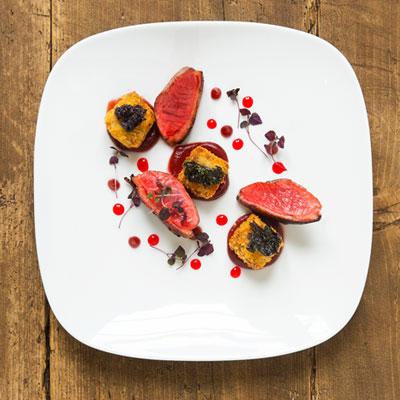 Seasonal meats on a plate white plate